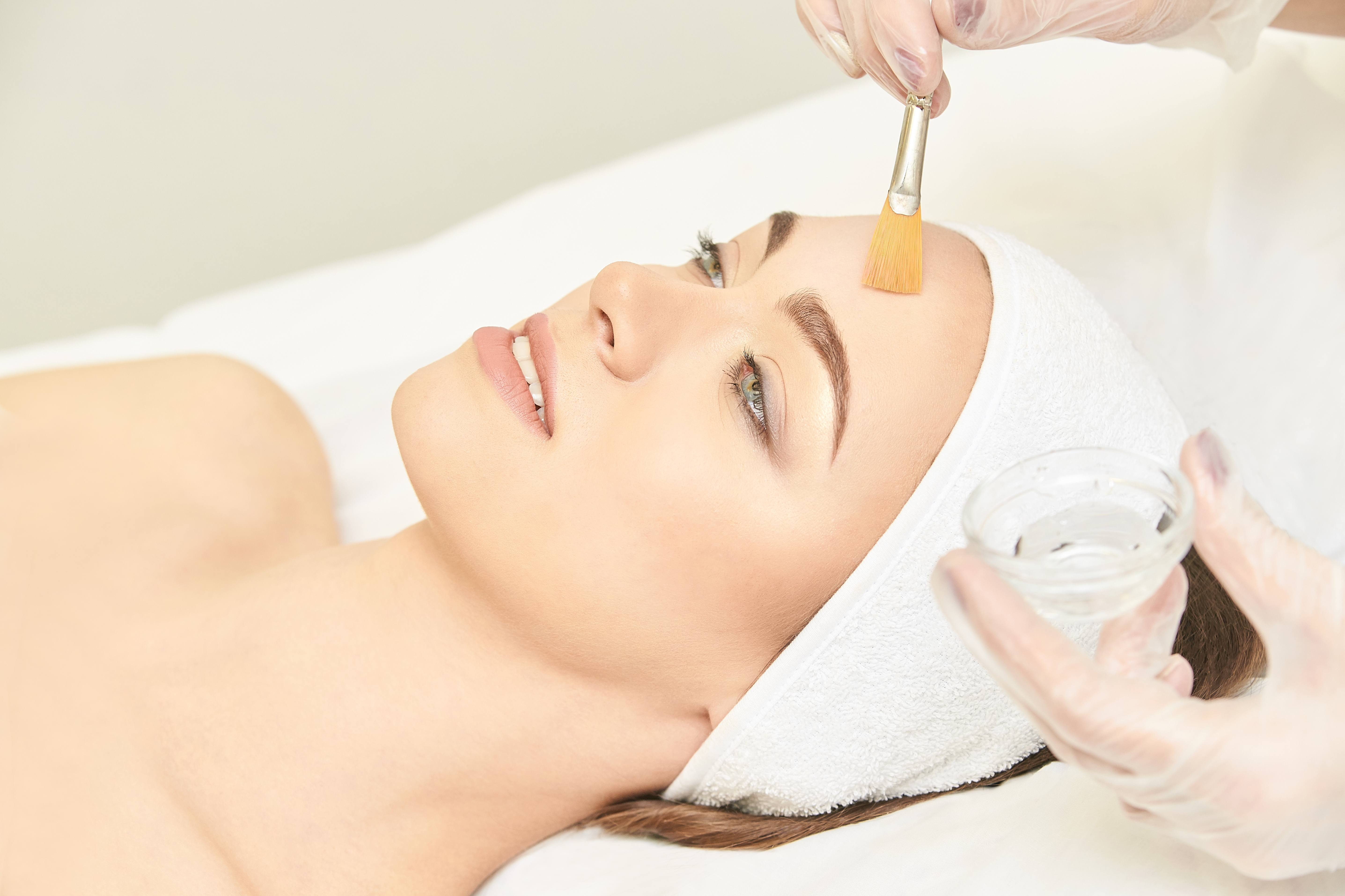 Facial brush peel retinol treatment. Beauty woman peeling ...